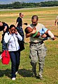 US Navy 100120-N-1240O-088 A U.S. soldier carries a Haitian boy injured in the recent earthquake to awaiting medical personnel.jpg