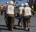 US Navy 100120-N-7508R-099 Marines aboard USS Bataan (LHD 5) carry a Haitian man to the ship's flight deck triage for immediate medical treatment.jpg