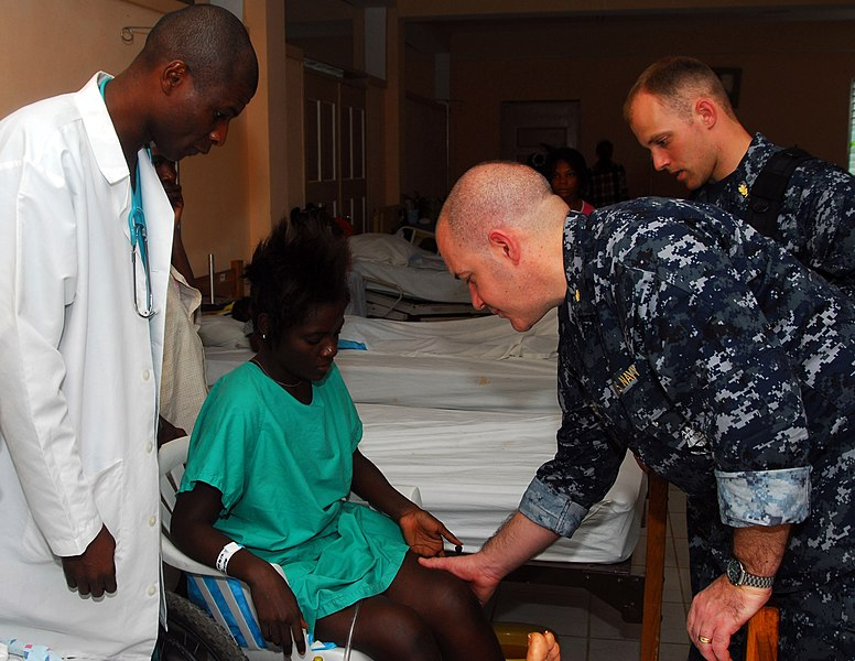 File:US Navy 100219-N-4047W-071 Cmdr. Sam Critides, from Glen Ridge, N.J., a neurosurgeon embarked aboard the Military Sealift Command hospital ship USNS Comfort (T-AH 20), performs a physical examination on a patient at St. Bonifac.jpg