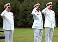 US Navy 100714-N-8132M-104 Chief of Naval Operations Adm. Gary Roughead, Brig. Gen. Abdulla Saeed Al Mansoori and Rear Adm. Patrick Lorge render a hand salute as the national anthems of the Kingdom of Bahrain and the United Sta.jpg