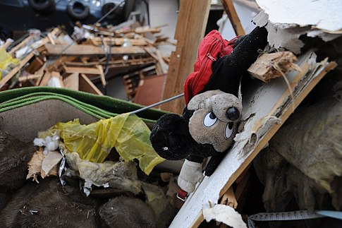 A Mickey Mouse doll lies among debris in Ofunato. Image: U.S. Navy.