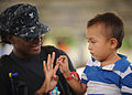 US Navy 110715-N-NY820-340 Hospital Corpsman 3rd Class Chavone Taylor plays with a pediatrics patient during a Continuing Promise 2011 community se.jpg