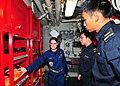 US Navy 110825-N-XR557-091 Damage Control Assistant Lt. j.g. Caroline Adler, left, shows Republic of Singapore navy officers Lt. Bryan Low, center.jpg