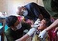 US Navy 111023-N-VP123-169 Capt. Roland McCoy, a dentist assigned to Commander, Task Force 73, observes a Royal Cambodian Armed Forces dentist admi.jpg