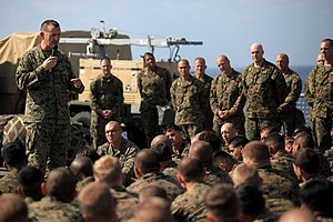 US Navy 111230-M-YP701-007 Col. Michael Hudson, commanding officer of the 11th Marine Expeditionary Unit (11th MEU), speaks to Sailors and Marines.jpg