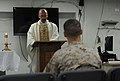 US Navy 120124-N-ZZ999-054 Staff Sgt. Matthew S. Thompson listens to Lt. Leo F. Arnone, a Navy chaplain, as he reads scripture during catholic mass.jpg