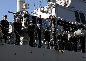 US Navy 120130-N-YF783-036 Sailors man the rails of USS Arleigh Burke.jpg