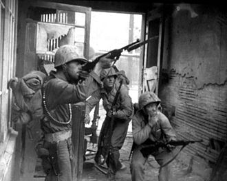 Second Battle of Seoul - U.S Marines return fire from North Korean snipers as they fight street to street in the South Korean capital of Seoul in September 1950