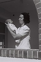 VETERAN KIBBUTZ MEMBER SARA BUSSEL GILAD WITH HER GRANDCHILD AT DEGANIA B. חברת קיבוץ דגניה ב' עם נכדה.D835-006.jpg