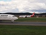 VH-TJG and VH-VZV at Canberra Airport in October 2012.JPG