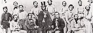 Origins of Australian rules football - The Victorian XI, 1859. In May of that year, Tom Wills (seated, far left), William Hammersley (standing, third from left), J. B. Thompson (seated, second from left) and Thomas H. Smith (not pictured) met at the Parade Hotel, run by Jerry Bryant (standing, second from right), where they wrote the first laws of Australian football.