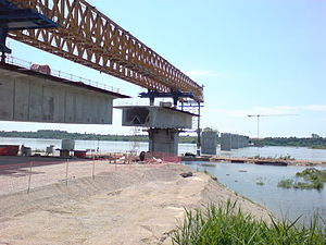 New Europe Bridge -  Construction of the Vidin–Calafat Bridge as seen in 2010 on the Bulgarian river bank. View towards the small island in the Bulgarian non-navigable part of the Danube river. The ferry boat terminal is about 4km down the river from the bridge.