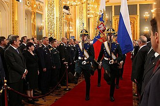 Third inauguration of Vladimir Putin - Soldiers are carrying the Flag of Russia and the Flag of President of Russia