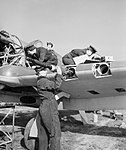 WAAF armourers and flight mechanics servicing a Hawker Hurricane at Sealand in Wales, 5 May 1943. CH10090.jpg