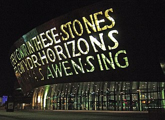 Welsh literature in English - The Wales Millennium Centre at night whose bilingual inscription consciously evokes Wales' dual literary tradition.