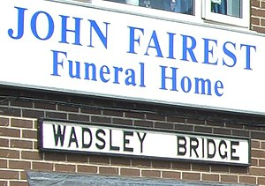 Wadsley Bridge railway station - Old station sign at John Fairest Funeral Home.