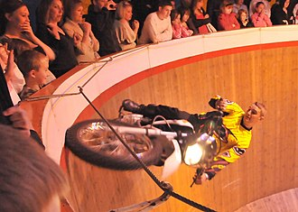 Wall of death - The audience looks on as the stunt rider passes nearby.
