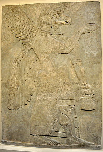 Apkallu - Wall relief depicting an eagle-headed and winged man, Apkallu, from Nimrud.