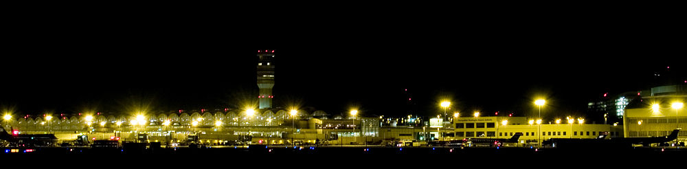 A view of the airport from the north, showing terminals B and C, taken from Gravelly Point, a popular park for watching planes take off or land