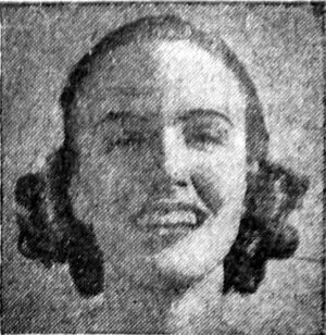 Black and white photograph of a smiling woman