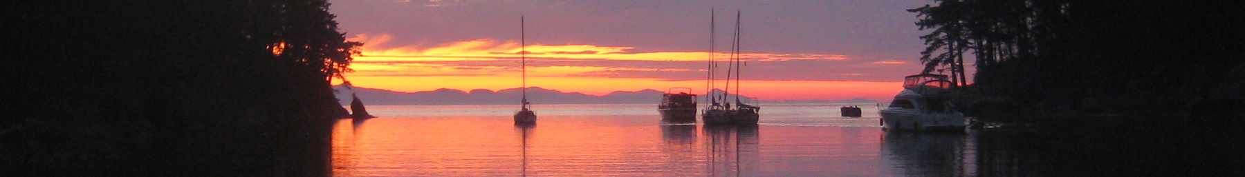 sailboats at sunset in the San Juan Islands of Washington State