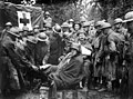 Wounded German POWs receiving medical attention from Americans 1918-09-12.JPEG