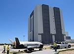 X-37B OTV4 passing Vehicle Assembly Building (170507-F-LD992-008).jpg