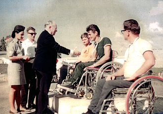 Australia at the Paralympics - Tony South receives his gold medal for the archery Albion Round in Tel-Aviv at the 1968 Summer Paralympics from the founder of the Paralympic movement, Ludwig Guttmann.