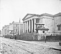 """Large public building, railings, steps, 6 columns in portico, 2 guns on plinths, one plinth inscribed India"" is Tralee Courthouse (34587277922).jpg"