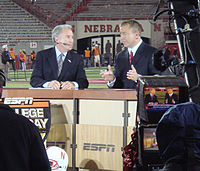 "Lee Corso and Kirk Herbstreit discuss college football on an evening update of ESPN College Gameday. Herbstreit tells the old joke ""What does the N on the Nebraska helmet stand for? Knowledge!"""