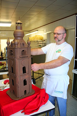 Chocolatier - A chocolatier making a chocolate tower