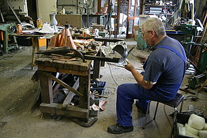Coppersmith - Dinandier (Coppersmith) at work in the last workshop of brassware subsisting in Dinant (Belgium).