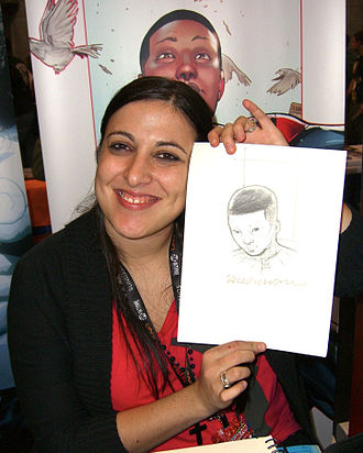 Spider-Man (Miles Morales) - Artist Sara Pichelli, who designed Morales, holding a sketch of him at the 2011 New York Comic Con