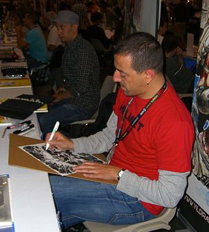 Yıldıray Çınar - Çınar sketching at the New York Comic Con. To his left is fellow Turkish comics creator Mahmud A. Asrar.