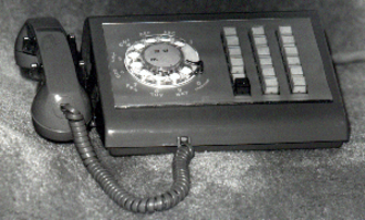 1A2 Key Telephone System - A typical rotary dial key telephone: the Western Electric eighteen button Call Director, manufactured from 1958 to the early 80s.