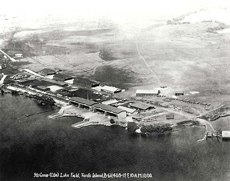 Aerial photo of shoreline buildings and docks