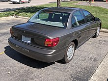 2000-2002 Saturn SL1 rear view, showing the different trunk and unpainted plastic door handles of this cheaper model.