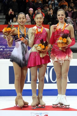 2007–08 Grand Prix of Figure Skating Final - The ladies' podium. From left: Mao Asada (2nd), Kim Yuna (1st), Carolina Kostner (3rd).