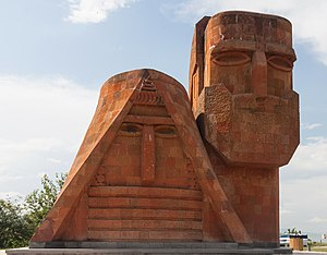 """We Are Our Mountains - """"We are our mountains"""" monument depicting a man and a woman"""