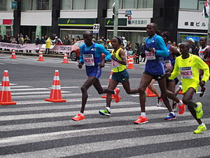 2015 Tokyo Marathon - The leading pack of elite men during the race (Tsegaye Kebede is centre wearing number 2)