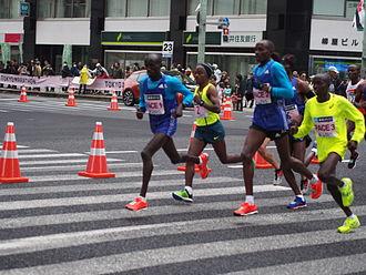 2015 Tokyo Marathon - The leading pack of elite men during the race (Tsegaye Kebede is centre wearing number 2)