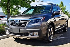2017 Ridgeline Touring With Oem Accessory Grille Door Trim Running Boards Tonneau Roof Rails And Crossbars Note The Standard Skid Plate On This Model