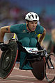 231000 - Athletics wheelchair racing 800m T52 final Greg Smith gold action 3 - 3b - 2000 Sydney race photo.jpg