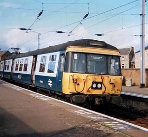 British Rail Class 311 - Unit 311104 in blue/grey livery awaiting passengers at Partick