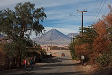 Licancabur seen from a tree-lined town road