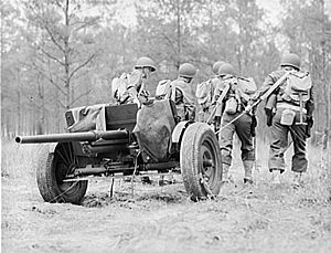 37 mm Gun M3 - Manhandling a gun into position during training at Fort Benning, 1942. Note the raised wheel segments.