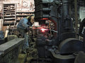 4 artist blacksmith forging with power hammer.JPG
