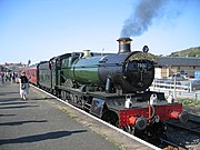 Preserved GWR locomotive Bradley Manor, until recently still used on Britain's national rail network. Between the two oil lamps signifying an express passenger service a high-intensity electric lamp has been added to comply with modern safety standards