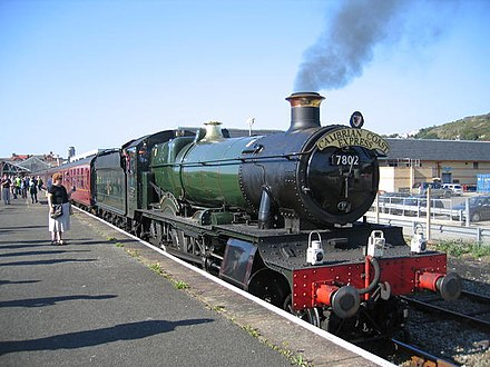 Preserved Great Western Railway locomotive Bradley Manor, with two oil lamps signifying an express passenger service, and a high-intensity electric lamp added for safety standards. 7802 Bradley Manor.jpg