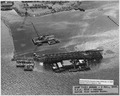 ASBF (VJ1) ^23028- 6 Nov 1943. USS Utah- Salvage, Aerial view toward shore - NARA - 296981.tif